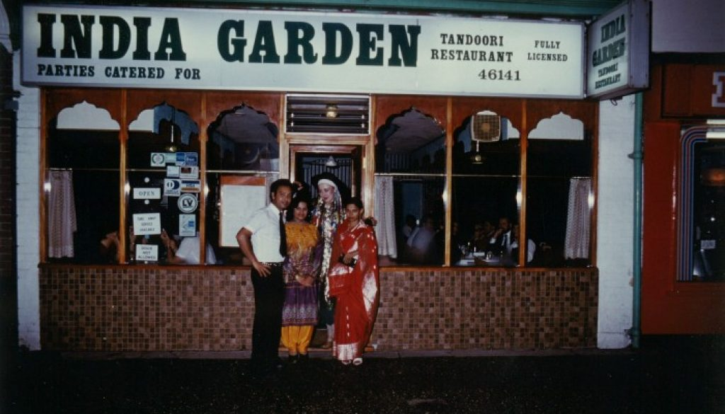 The team outside the restaurant many years ago